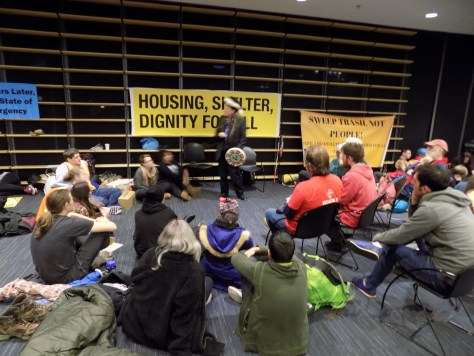 Image 2 Caption--Protestors divided into working groups Wednesday night.