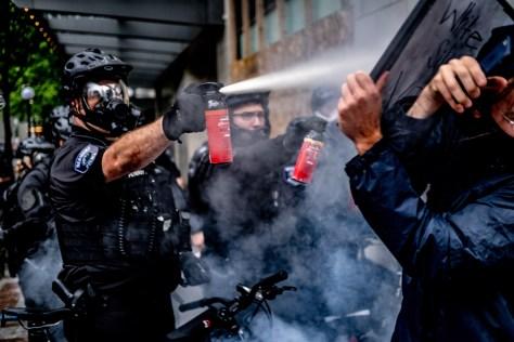 Redmond Washington  Police Officer Spraying Protesters