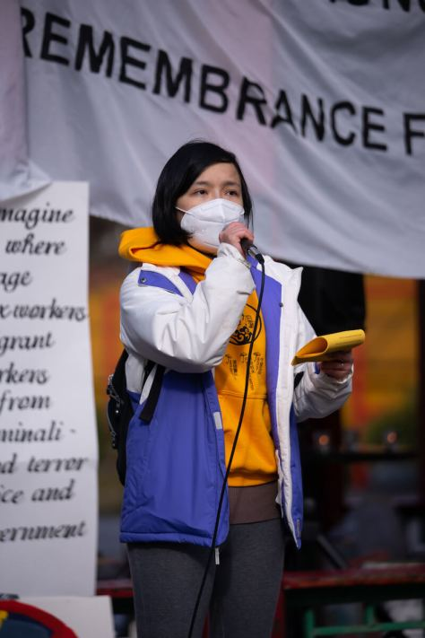 A representative of MPOP (Massage Parlor Outreach Project 女工互助小组) addresses a crowd gathers at Seattle's Hing Hay park. (Photo: Chloe Collyer)