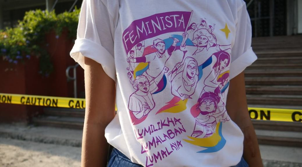 Student protester stands in front of Palma Hall at the University of the Philippines Diliman last year on International Women's Day. (Manila, Philippines) (Photo credit: Ronnie Estoque)