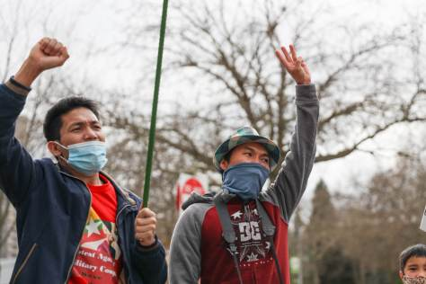 Two protesters call for the end to a military coup in Myanmar/Burma. The Seattle rally on Friday included members of the Burma/Myanmar Student Association at UW among the participants.