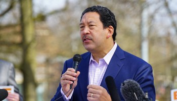 Bruce Harrell holding a microphone and announcing his candidacy for Seattle mayor.