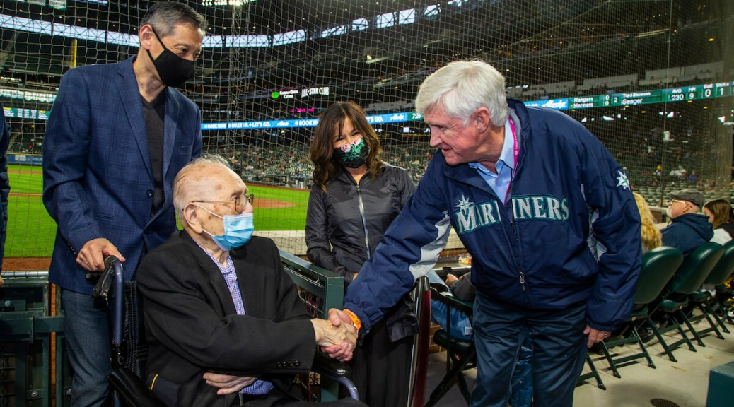 Featured Image: Mariners Chairman and Managing Partner John Stanton shakes Gene Moy's hand at the Mariners' Asian American Pacific Islander Heritage Night. (Photo by Ben VanHouten/Seattle Mariners.)