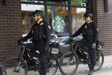 SPD bicycle officers stop in front of a Starbucks as they followed protesters closely.