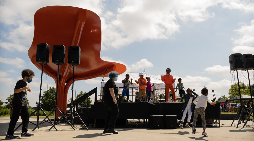 Black youth dance on and off stage at Jimi Hendrix Park.