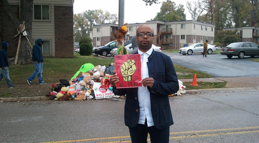 Tyrone Brown at the spot where Michael Brown was killed in 2014 in Ferguson, Missouri.
