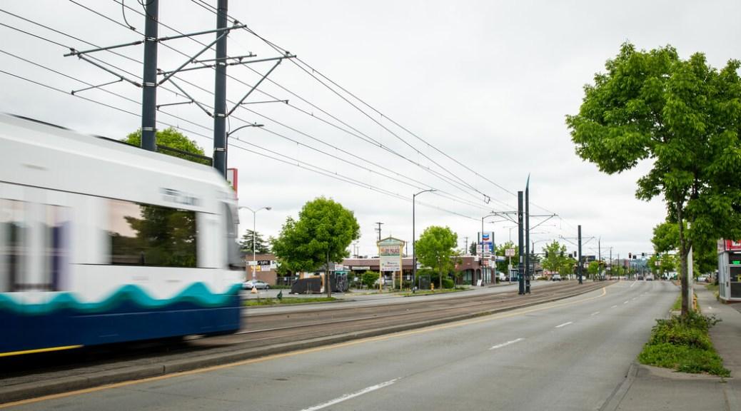 A link light rail shuttle passes by Graham Street and Rainier Avenue.