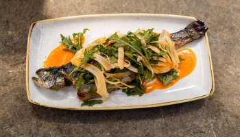 Photo of Daing na rainbow trout, a whole-smoked trout dish, from Musang's new spring menu.