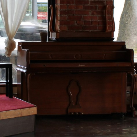 The piano at Hillman City Collaboratory where Joe, the mortician, played jazz and blues standards daily before his death in 2021.