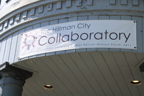A sign for the Hillman City Collaboratory hanging on the exterior of its building.