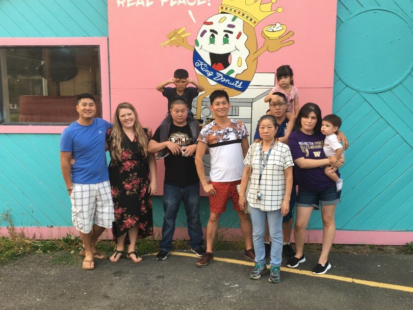 From left to right: Johnny Chhuor and Kelsey Chhuor, Michael Chhuor and his son Timothy on his shoulders, Hong Chhuor, Kim Sok, Travis Chhuor with his daughter Kathryn Chhuor on his shoulders, and Diana Chhuor with her son, Kai.