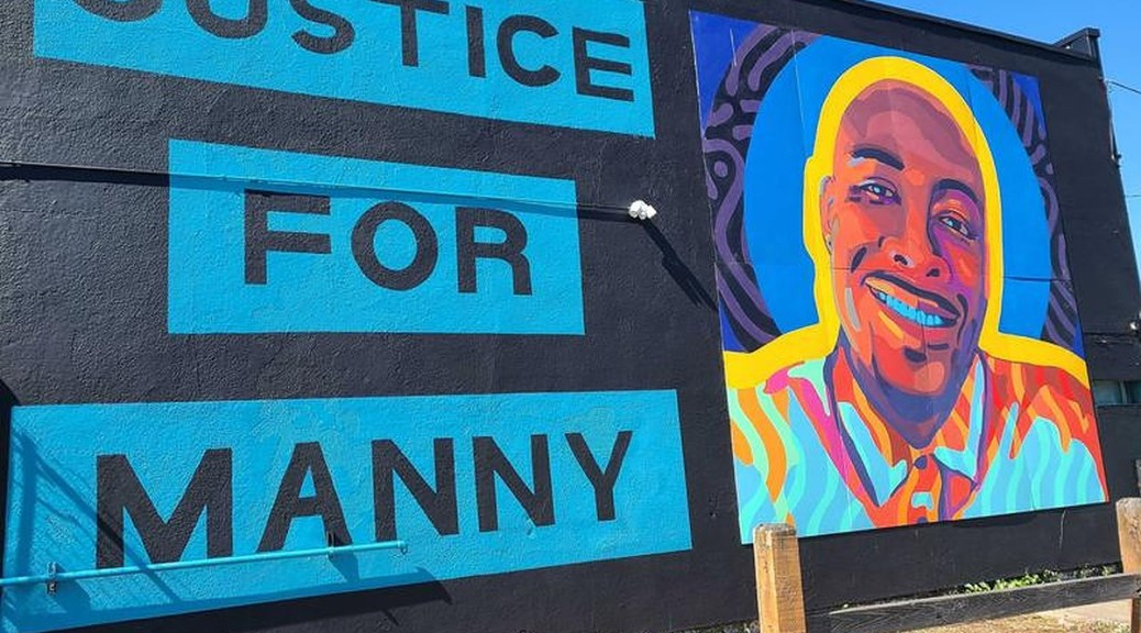 A mural honoring Manuel Ellis and calling for justice in his death fills a wall in Tacoma's Hilltop neighborhood.