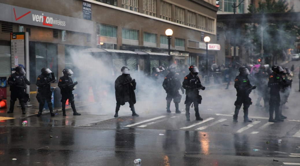 Photo of SPD officers responding to BLM protests in Seattle.