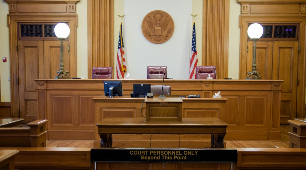 Photo of an empty U.S. courtroom.