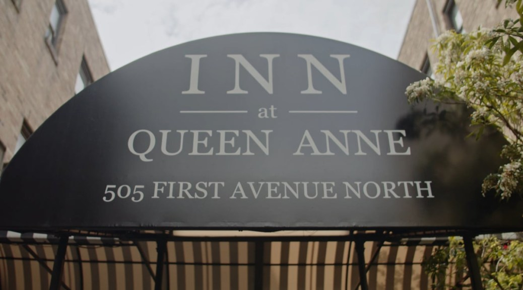Exterior sign of the Inn at Queen Anne.
