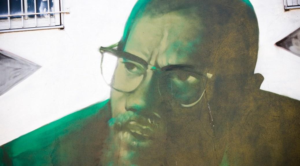 Photograph of an art mural of Malcolm X.