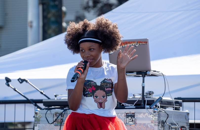 Young performer and entrepreneur Skye Dior performs before a large crowd.