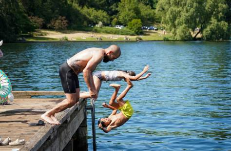 Joshua Dodd and his children Nile 8, and Bay 11, dive into Lake Washington to escape record setting temperatures in June. (Photo: Susan Fried)