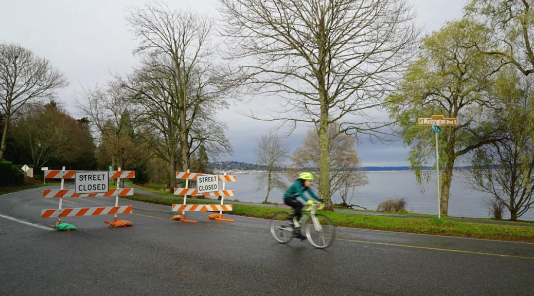 A bicyclist rides along Lake Washington Boulevard.