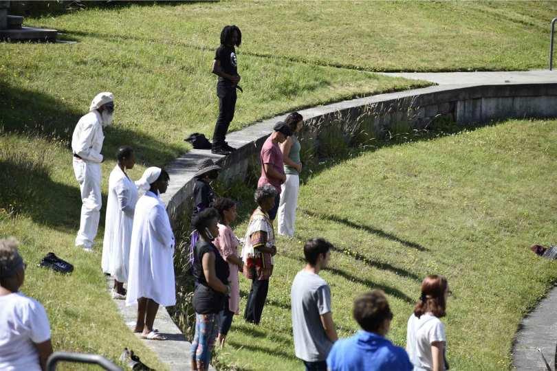 "Spectators partake in Nile's Edge Healing Arts ""No Healing, No Peace"" Walking Meditation for Black Liberation on Juneteenth 2021."