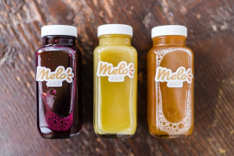 Bottles of Melo's bottled juices, Melo Type Beet, Melo Original, and Melo Apple. (Photo: Melo Cafe)