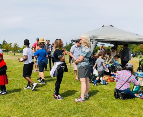 Parents Grace Coleman, left, and Sarah Heath brainstorm a pen pal project for fourth graders at Green Lake and Rising Star elementary schools during a June 2019 soccer scrimmage co-hosted by parent associations at both schools.