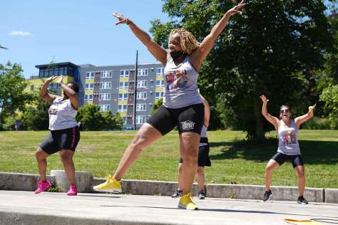 Dance Fitness Collective 206 performs choreography during the It Takes a Village event.