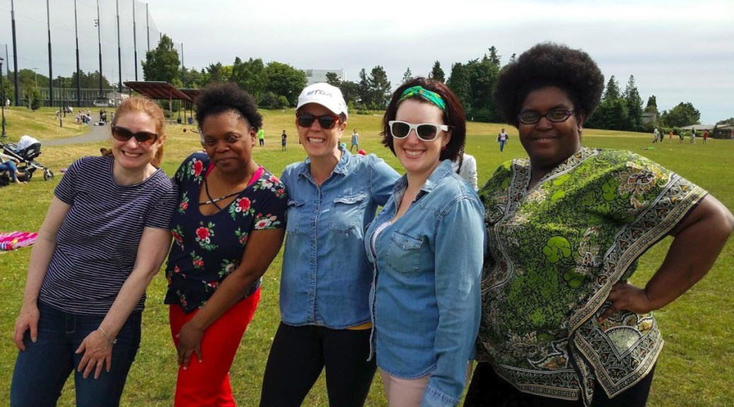 Mothers Gwyn Hainsworth, far left, Vernee Fletcher, Jamie Zimmerman, Katy Strange, and Leticia Bazemore pose at Jefferson Park in Seattle during a June 2019 soccer scrimmage.