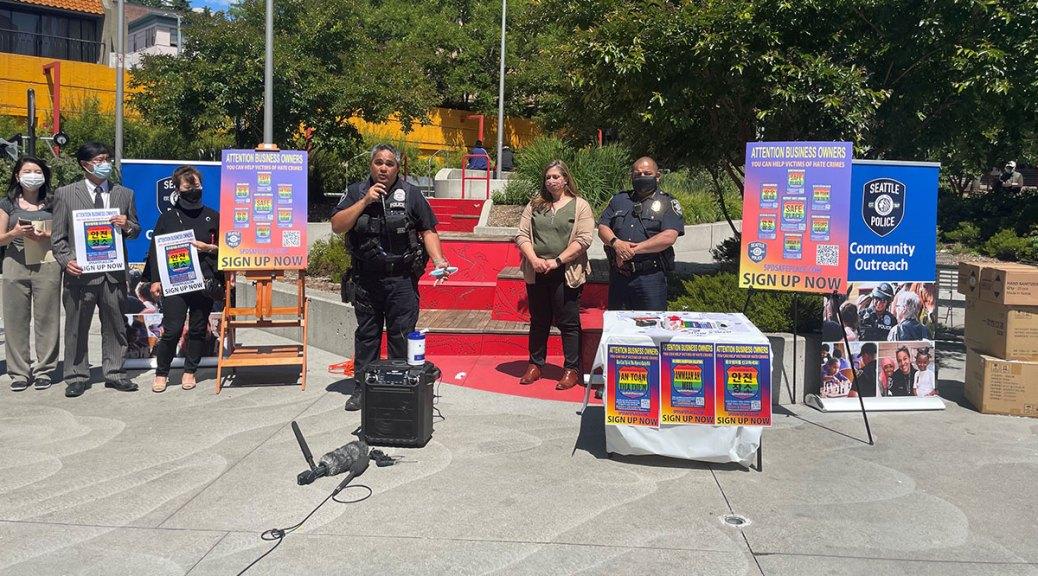 Interim SPD Chief Adrian Diaz, detective Beth Wareing, and LGBTQ liaison Dorian Koreio at Hing Hay Park.