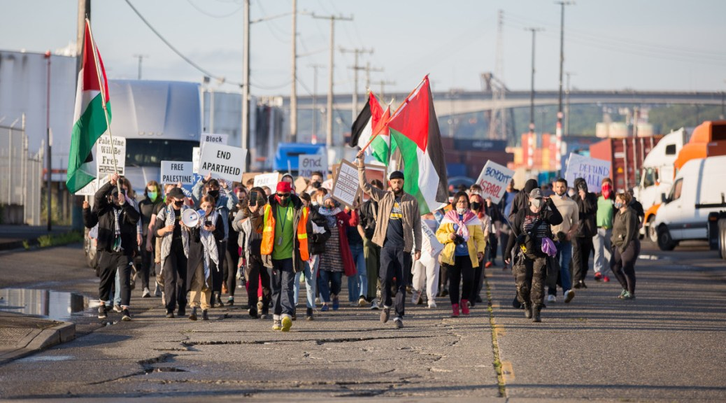Photo of activists marching at the Port of Seattle to stop the unloading of a ship owned by an Israeli company.
