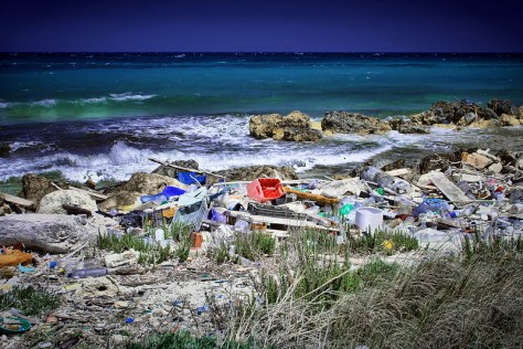 Photo of an overwhelming amount of plastic pollution piled on a beach.