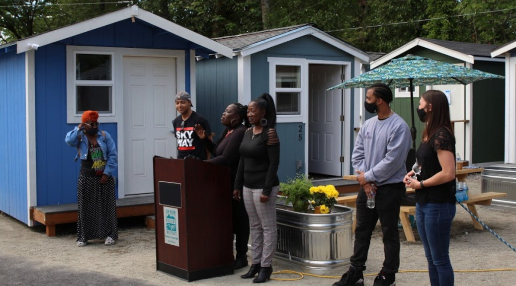 Featured image: Skyway residents speak at a June 8, 2021 press conference announcing the June 15 opening of a tiny home village in the neighborhood. (Photo: Jack Russillo)
