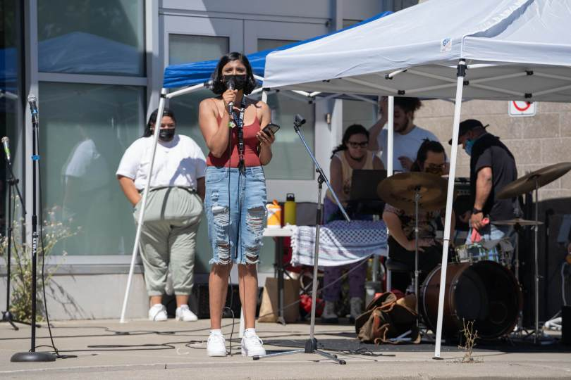 Ruba Ayub addresses the crowd outside of Rainier Beach Community Center.