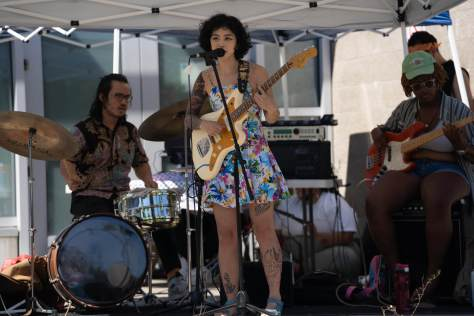 Cody Choi and the band Bananaganz perform at the youth-lead mutual aid pop-up outside Rainier beach community center on one of Seattle's hottest days on record.