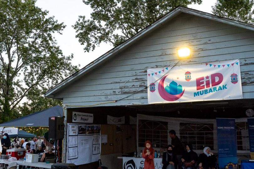 """Photo of the exterior of the CRC annual night market with a banner across the top of the building in pink and blue lettering reading """"Eid Mubarak."""""""