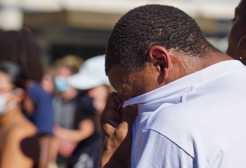 A family member cries during the #Breathe for Kaloni rally on Saturday, July 24, 2021, at Westlake Park.