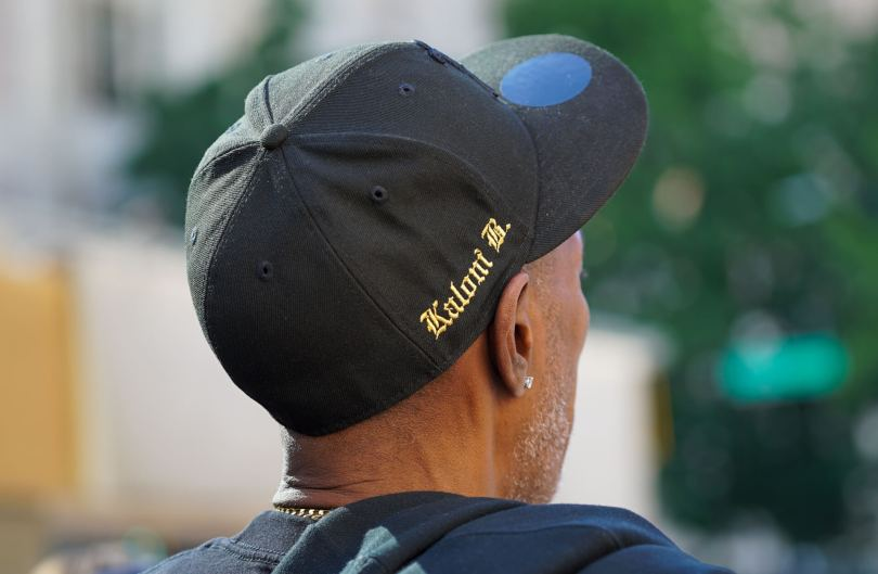 Kaloni Bolton's father, Kevin Bolton, wears a hat emblazoned with his daughter's name.