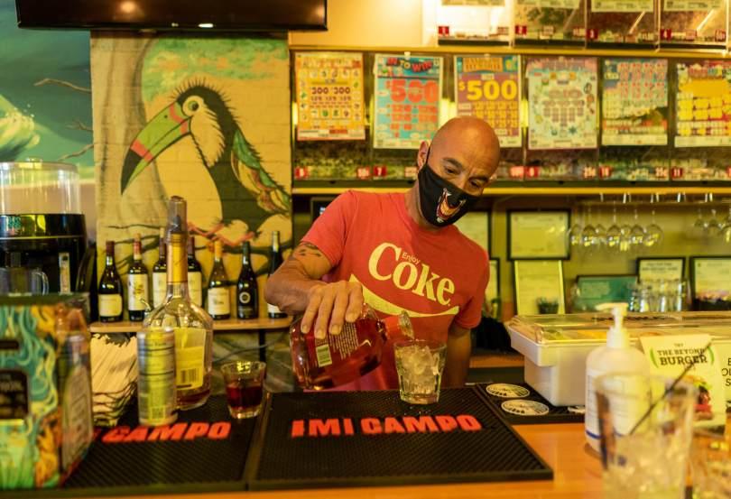 Beachcomber Bar and Grill bartender Jason De La Rosa pours a drink.