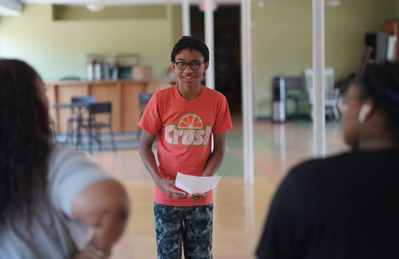 Nasir Forest-Parramore, 13, works on a monologue with members of the crew of the Teen Musical
