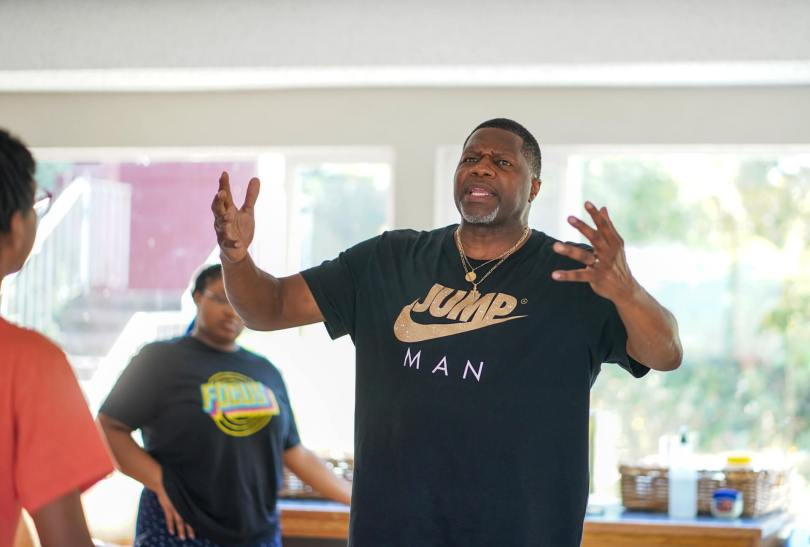 """Isiah Anderson, the director of the Teen Summer Musical """"Story of an Off-Brand Band,"""" rehearses"""
