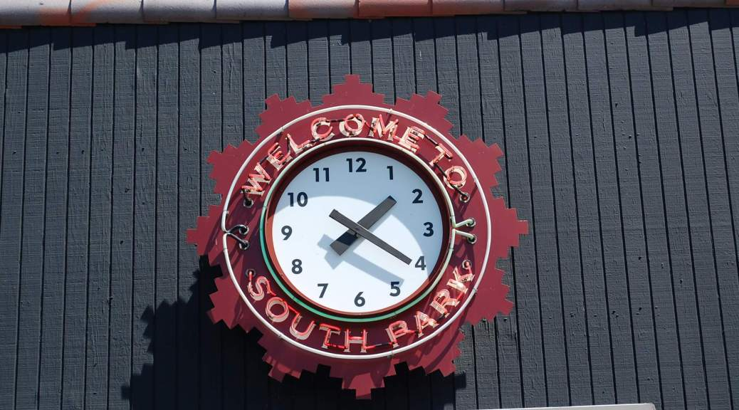 """Photo of the """"Welcome to South Park"""" sign and clock."""