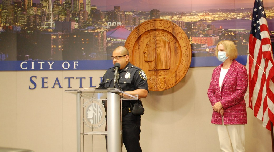 Interim Seattle Police Chief Adrian Diaz speaks at a July 26, 2021, press conference as Mayor Jenny Durkan looks on.