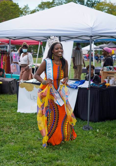 Photo of Jamerika Haynes-Lewis wearing a crown and colorful gown as well as her USA Ambassador Ms. 2021 sash.