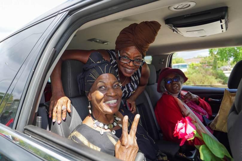 Photo of Central District Elders Kibibi Monie, Dawn Mason, and Harriet Walden in the interior of a parade car.