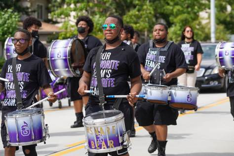 Photo of the Dolls and Gents Drumline marching.