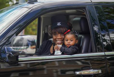Photo of Renee and her 1-year-old granddaughter in the interior of a parade car.