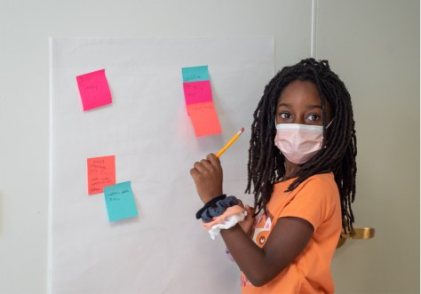 Arianna Davis, 10 writes down ideas for the film she and her fellow students made during the five-day Reel Youth Film Camp August 16–20 at the Rainier Arts Center. (photo: Susan Fried)