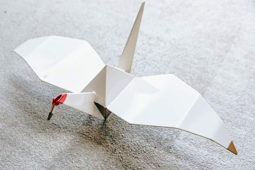 Photo depicting one of Chinn's lightweight origami-style sculpted crane with a read head.