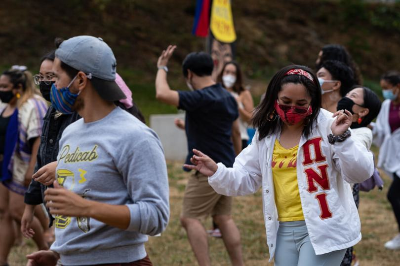 Local Filipino American community members get their groove on and dance during the event.