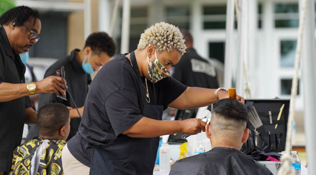 Jocelyn Mayhle from Frank's Barbershop does a free haircut